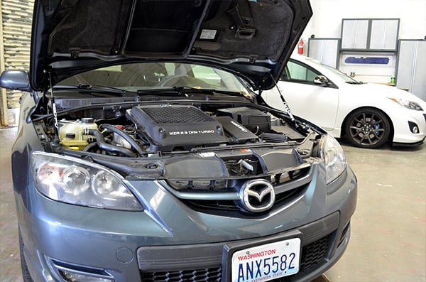 Axe_8_700_Mazda3_hoodstru_installed3